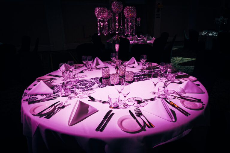 Luxurious table setting at evening event with Spot Lighting Brisbane